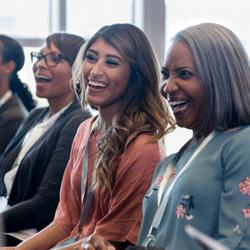 Diverse, smiling women attending an event